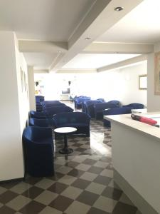 The lobby or reception area at Hotel Scaranò