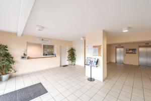 The lobby or reception area at City Résidence Marseille