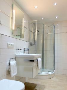 Ein Badezimmer in der Unterkunft Hotel AlpinaRos Demming