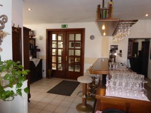 Ein Sitzbereich in der Unterkunft Hotel & Restaurant Kleinolbersdorf
