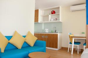 A kitchen or kitchenette at BX Hotel Apartment