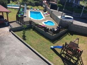 A view of the pool at Hotel Azcona or nearby