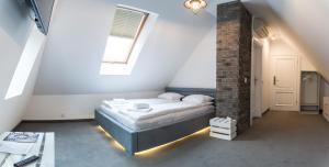 Ein Bett oder Betten in einem Zimmer der Unterkunft Dworek Admirał