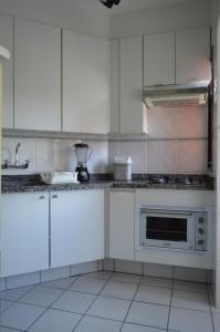 A cozinha ou cozinha compacta de Edifício Graceland - Caiobá
