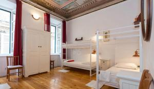 A bunk bed or bunk beds in a room at Old Town Hostel