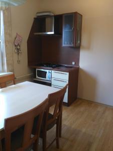 Кухня или мини-кухня в Апартаменты «ApartmentHouse»