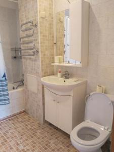 Ванная комната в Апартаменты «ApartmentHouse»