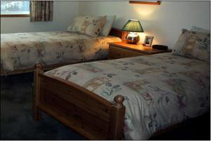 A bed or beds in a room at Birch Meadows Lodge B&B