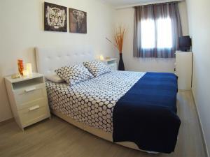 Cama o camas de una habitación en La Torre Oceanside