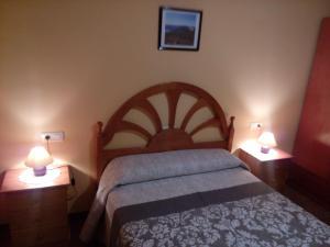 Cama o camas de una habitación en Apartamentos Casa Ferrás