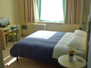 Letto o letti in una camera di Villa Paola