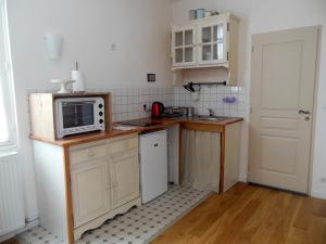 Cuisine ou kitchenette dans l'établissement L'Expressoir-Maison d'hôtes