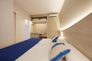Säng eller sängar i ett rum på Son Caliu Apartamentos