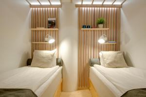 A bed or beds in a room at Dream Hostel & Hotel Tampere