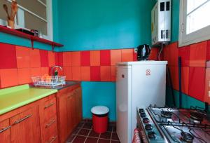 Una cocina o zona de cocina en Casa Violeta Limón