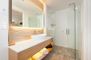 A bathroom at Allure On Ocean Motel