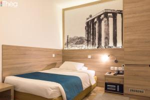 Ένα ή περισσότερα κρεβάτια σε δωμάτιο στο Ξενοδοχείο Μαριάννα