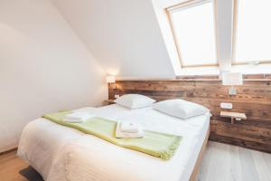 Ein Bett oder Betten in einem Zimmer der Unterkunft Weinwirtshaus Wlaschits