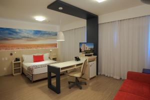A television and/or entertainment center at Comfort Suites Alphaville