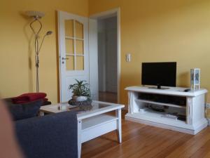 Телевизор и/или развлекательный центр в Ferienwohnung Sommer