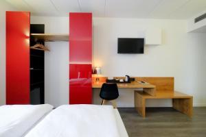 Een bed of bedden in een kamer bij Hotel Corsendonk Viane