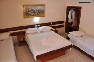 A bed or beds in a room at Hotel Master