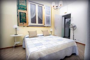 A bed or beds in a room at La Gioia