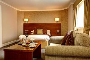 A bed or beds in a room at Golden Lion Hotel