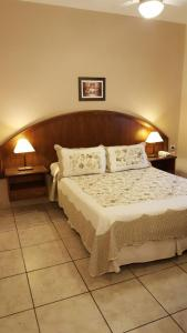 A bed or beds in a room at Hotel Suma Huasi