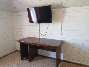 Телевизор и/или развлекательный центр в Hotel Kazachy Stan