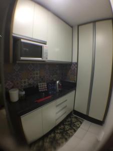 A kitchen or kitchenette at Lindo Studio Av. Ipiranga