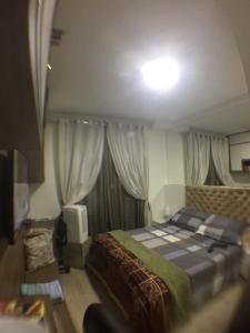A bed or beds in a room at Lindo Studio Av. Ipiranga