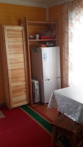 Кровать или кровати в номере Guest house Tihaya ulochka