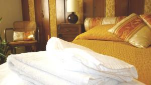 Letto o letti in una camera di Romulus Rex