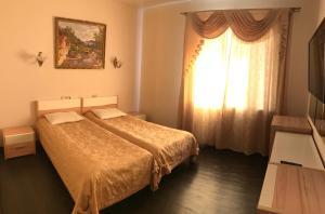 Кровать или кровати в номере Гостиница Форт Нокс
