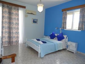 A bed or beds in a room at Alexia Apartments & Studios