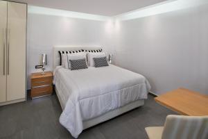 Un ou plusieurs lits dans un hébergement de l'établissement Elea Resort - Adults Only