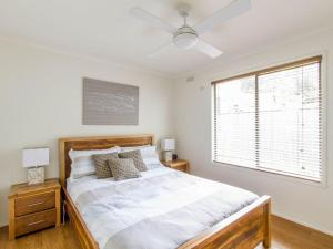 A bed or beds in a room at Perfect for Family Fun