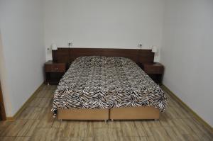 Кровать или кровати в номере Апартаменты Декабристов