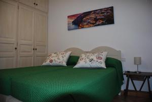 Letto o letti in una camera di Casa Angelica Positano