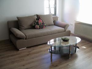 Ein Sitzbereich in der Unterkunft Ferienhaus Zum Amthof