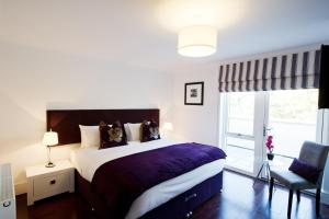 A bed or beds in a room at Forty Four Main Street