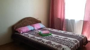 A bed or beds in a room at Амурский бульвар 56 Вокзал жд