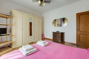 A bed or beds in a room at B&B A Casa Mia