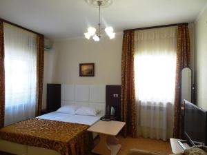 A bed or beds in a room at Guest House Centre