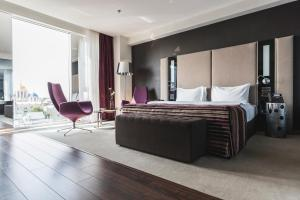 Ліжко або ліжка в номері 11 Mirrors Design Hotel