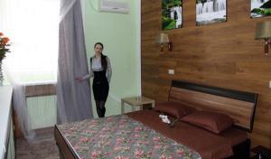 Кровать или кровати в номере Hotel Sfera Barnaul