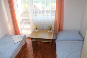 Posteľ alebo postele v izbe v ubytovaní Chatisko