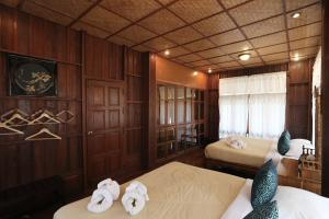 A bed or beds in a room at Siam Villa