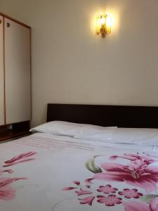 A bed or beds in a room at Albergo Luca